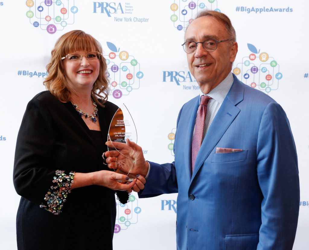 Lea-Ann Germinder, APR Fellow PRSA receiving the Makovsky Excellence in Mentoring Award from Ken Makovsky at the Big Apple Awards.